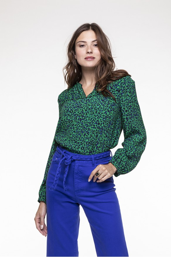 Green and black spotted printed top with long sleeves