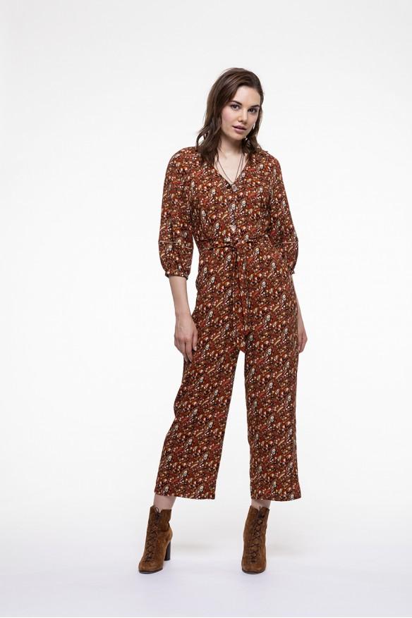 Combinaison pantalon à l'imprimé fleuri fond camel