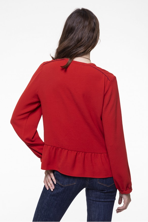 Red fluid long-sleeved top