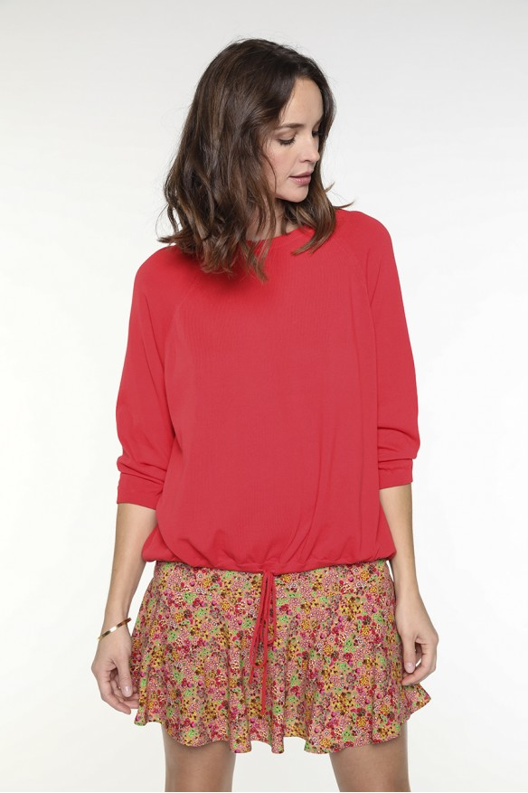 Orange-red pullover with...