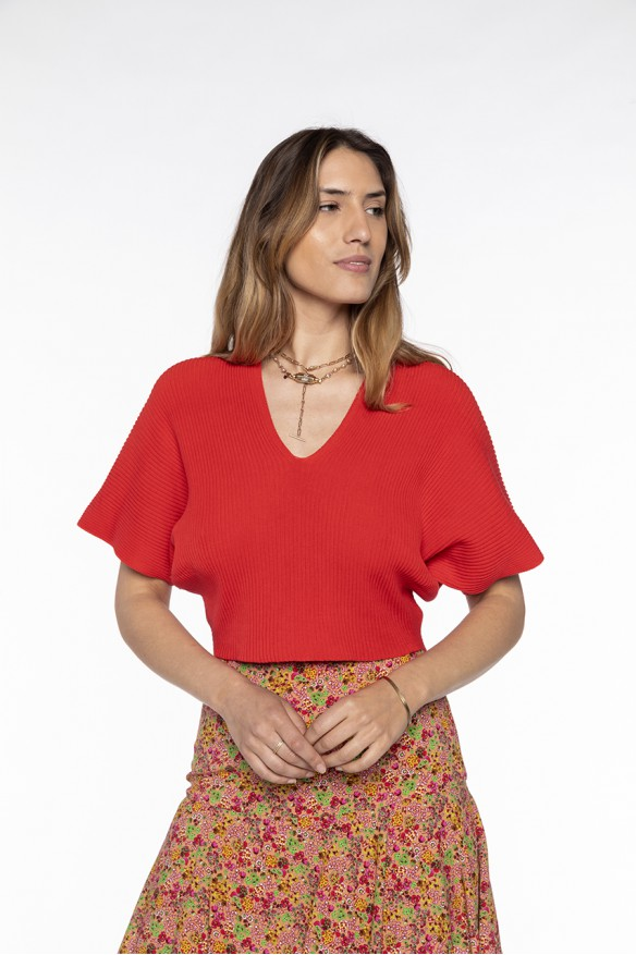 Red V-neck ribbed jumper